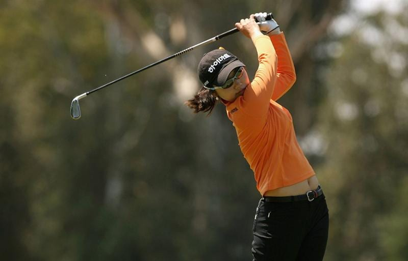 MELBOURNE, AUSTRALIA - FEBRUARY 14:  Hye Youn Kim of Korea plays her second shot on the fifth hole during day three of the 2009 Women`s Australian Open held at the Metropolitan Golf Club February 14, 2009 in Melbourne, Australia.  (Photo by Robert Prezioso/Getty Images)
