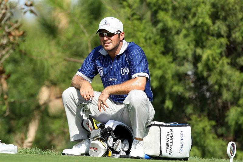 ORLANDO, FL - MARCH 16:  Trevor Immelman of South Africa and Lake Nona at the 17th hole during the first day of the 2009 Tavistock Cup at the Lake Nona Golf and Country Club, on March 16, 2009 in Orlando, Florida  (Photo by David Cannon/Getty Images)