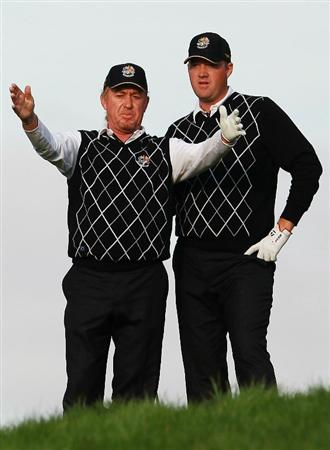NEWPORT, WALES - OCTOBER 03:  Miguel Angel Jimenez of Europe gestures to Peter Hanson (R) on the 18th green during the Fourball & Foursome Matches during the 2010 Ryder Cup at the Celtic Manor Resort on October 3, 2010 in Newport, Wales.  (Photo by Andrew Redington/Getty Images)