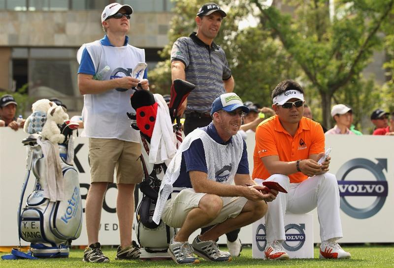 CHENGDU, CHINA - APRIL 22:  Padraig Harrington of Ireland and Y E Yang of Korea looks on during day two of the Volvo China Open at Luxehills Country Club on April 22, 2011 in Chengdu, China.  (Photo by Ian Walton/Getty Images)