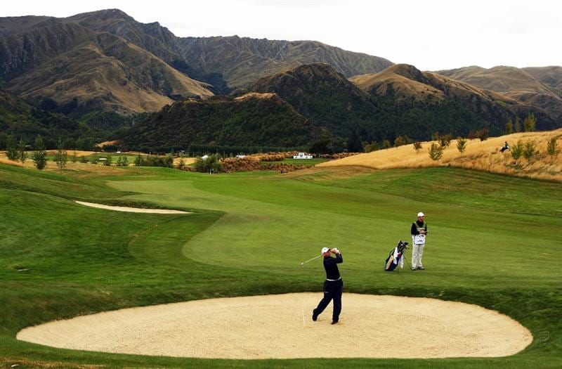 QUEENSTOWN, NEW ZEALAND - MARCH 12: Josh Teater of the USA plays out of a bunker on the 13th hole during day one of the New Zealand Men's Open Championship at The Hills Golf Club on March 12, 2009 in Queenstown, New Zealand.  (Photo by Phil Walter/Getty Images)
