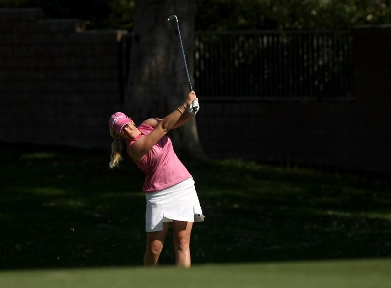 RANCHO MIRAGE, CA - APRIL 04:  Brittany Lincicome hits her second shot on the 15th hole during the third round of the Kraft Nabisco Championship at Mission Hills Country Club on April 4, 2009 in Rancho Mirage, California.  (Photo by Stephen Dunn/Getty Images)