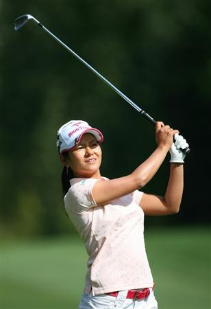 CALGARY, AB - SEPTEMBER 03: Ai Miyazato of Japan watches her third shot on the ninth hole during the first round of the Canadian Women's Open at Priddis Greens Golf & Country Club on September 3, 2009 in Calgary, Alberta, Canada. (Photo by Hunter Martin/Getty Images)