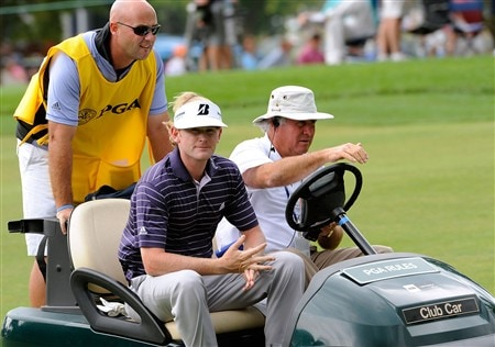 BLOOMFIELD HILLS, MI - AUGUST 09:  Rules Official Mike Shea (R) gives Brandt Snedeker (C) and his caddie Scott Vail (L) a ride off the course after the horn sounded indicating a weather delay during round three of the 90th PGA Championship at Oakland Hills Country Club on August 9, 2008 in Bloomfield Township, Michigan.  (Photo by Sam Greenwood/Getty Images)