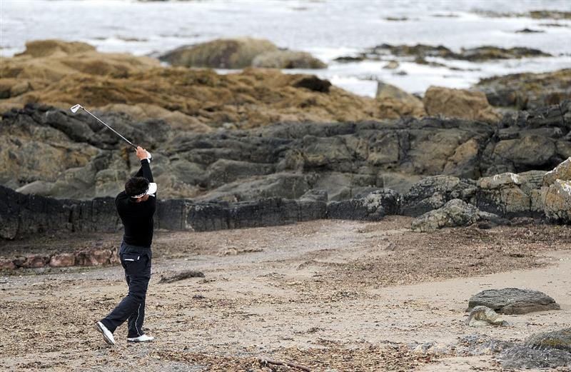 TURNBERRY, SCOTLAND - JULY 17:  Tomohiro Kondo of Japan hits off the beach by the 10th hole during round two of the 138th Open Championship on the Ailsa Course, Turnberry Golf Club on July 17, 2009 in Turnberry, Scotland.  (Photo by Stuart Franklin/Getty Images)