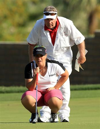 RANCHO MIRAGE, CA - APRIL 03:  Karen Stupples of England lines up a birdie putt at the 15th hole with the help of her caddie Jerry 'Woody' Woodard during the third round of the 2010 Kraft Nabisco Championship, on the Dinah Shore Course at The Mission Hills Country Club, on April 3, 2010 in Rancho Mirage, California.  (Photo by David Cannon/Getty Images)