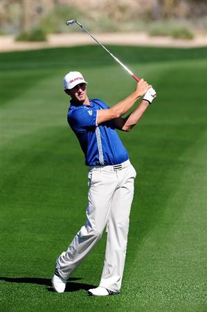 MARANA, AZ - FEBRUARY 16:  Dustin Johnson hits a shot during the second practice round prior to the start of the Accenture Match Play Championship at the Ritz-Carlton Golf Club on February 16, 2010 in Marana, Arizona.  (Photo by Stuart Franklin/Getty Images)