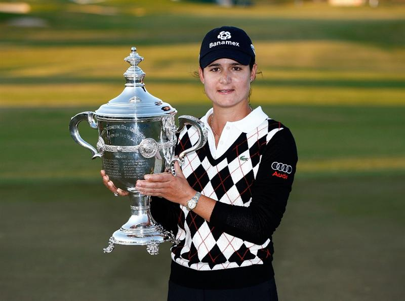 RICHMOND, TX - NOVEMBER 23:  Lorena Ochoa of Mexico poses with her Player of the Year trophy after the final round of the LPGA Tour Championship presented by Rolex at the Houstonian Golf and Country Club on November 23, 2009 in Richmond, Texas.  (Photo by Scott Halleran/Getty Images)