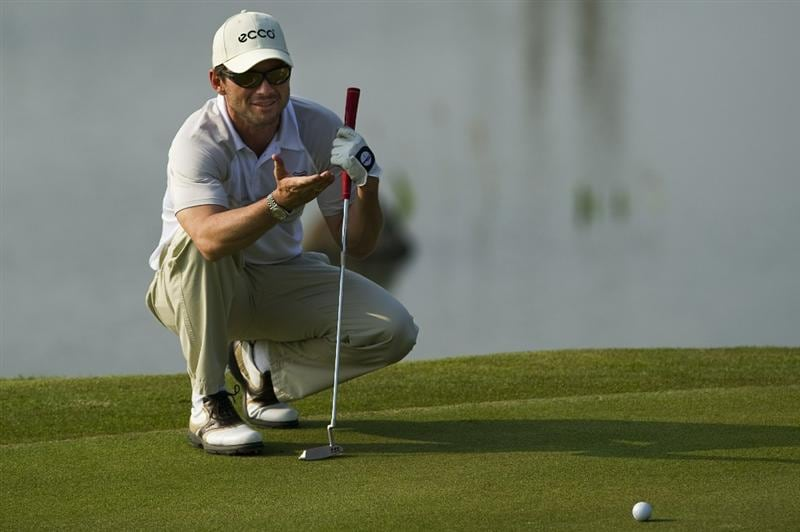 HAIKOU, CHINA - OCTOBER 30:  Hollywood actor Christian Slater of USA lines a putt on the 17th green during day four of the Mission Hills Start Trophy tournament at Mission Hills Resort on October 30, 2010 in Haikou, China. The Mission Hills Star Trophy is Asia's leading leisure liflestyle event and features Hollywood celebrities and international golf stars.  (Photo by Victor Fraile/Getty Images for Mission Hills)