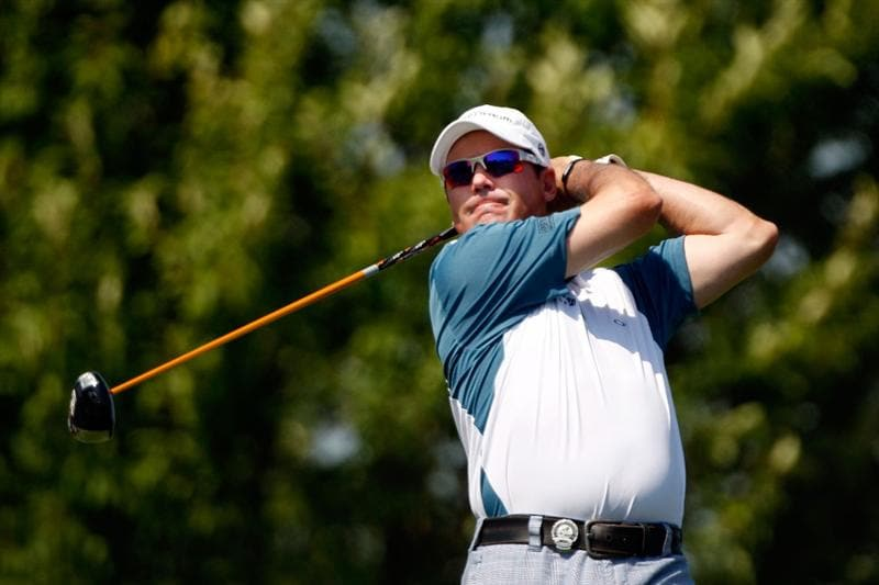 CHASKA, MN - AUGUST 14:  Rich Beem hits his tee shot on the third hole during the second round of the 91st PGA Championship at Hazeltine National Golf Club on August 14, 2009 in Chaska, Minnesota.  (Photo by Streeter Lecka/Getty Images)