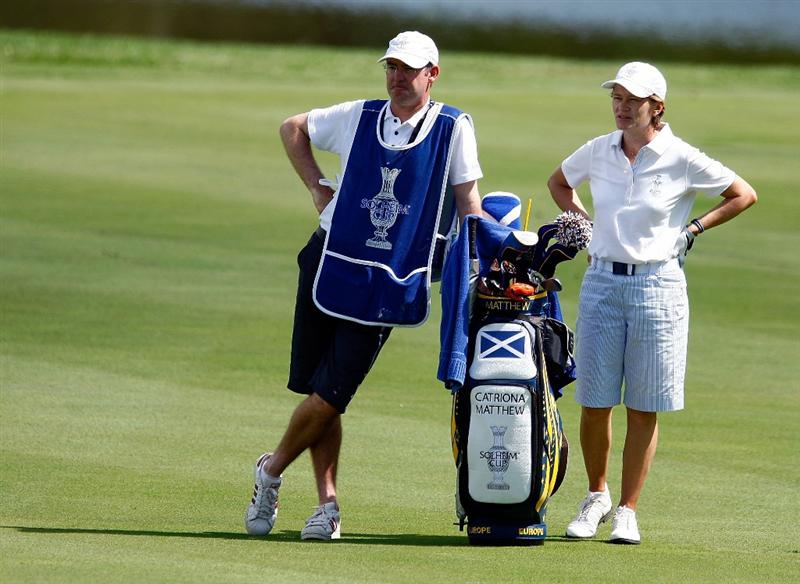 SUGAR GROVE, IL - AUGUST 18:  Catriona Matthew of the European Team waits with her husband/caddie Graeme in a fairway during a practice round prior to the start of the 2009 Solheim Cup at Rich Harvest Farms on August 18, 2009 in Sugar Grove, Illinois.  (Photo by Scott Halleran/Getty Images)
