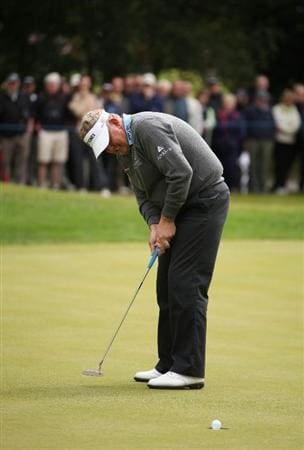 VIRGINIA WATER, ENGLAND - MAY 26:  Colin Montgomerie of Scotland plays holes a birdie putt on eleven during the first round of the BMW PGA Championship at Wentworth Club on May 26, 2011 in Virginia Water, England.  (Photo by Richard Heathcote/Getty Images)