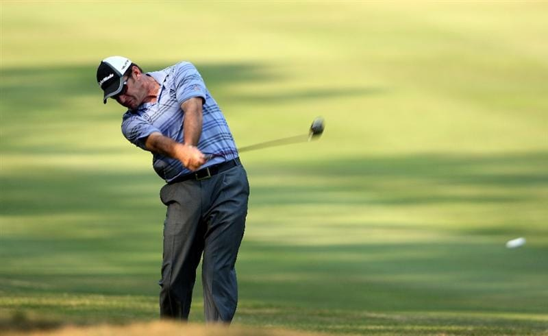 HONG KONG, CHINA - NOVEMBER 21:  Nick Faldo of England plays his approach shot on the 13th hole during the second round of the UBS Hong Kong Open at the Hong Kong Golf Club on November 21, 2008 in Fanling, Hong Kong.  (Photo by Stuart Franklin/Getty Images)
