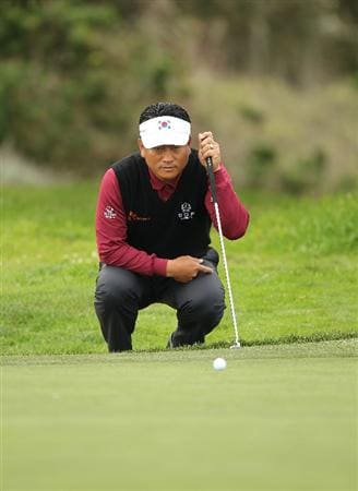 PEBBLE BEACH, CA - FEBRUARY 12:  K.J. choi of South Korea lines up a putt on the 13th hole during round two of the AT&T Pebble Beach National Pro-Am at the Monterey Peninsula Country Club Shore Course on February 12, 2010 in Pebble Beach, California.  (Photo by Ezra Shaw/Getty Images)