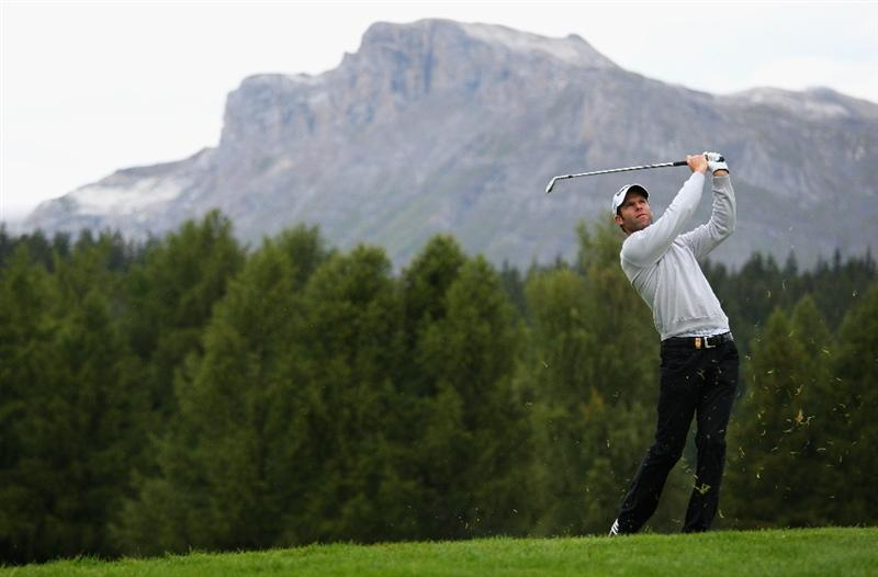 CRANS, SWITZERLAND - SEPTEMBER 04:  Bradley Dredge of Wales hits his second shot on the 12th hole during the first round of the Omega European Masters at Crans-Sur-Sierre Golf Club on September 4, 2008 in Crans Montana, Switzerland.  (Photo by Andrew Redington/Getty Images)
