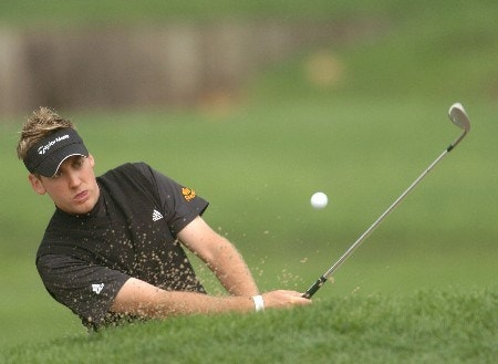 Ian Poulter holes out from the bunker on the 5th during the Quarterfinal round at the WGC Accenture Match Play Championship held at the LaCosta Resort and Spa on Saturday, February 26, 2005.  Poulter defeated Nick O'Hern 3 and 1.