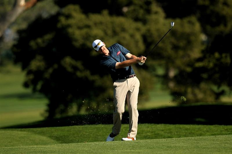 LA JOLLA, CA - JANUARY 28:  Tom Gillis hits his second shot on the fifth hole at the North Course atTorrey Pines Golf Course during the first round of the Farmers Insurance Open on January 28, 2010 in La Jolla, California.  (Photo by Stephen Dunn/Getty Images)
