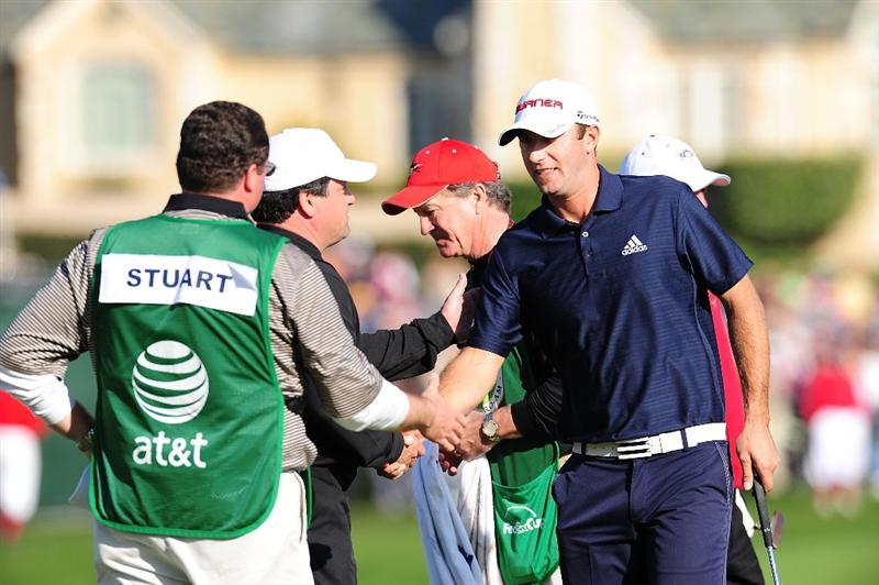 PEBBLE BEACH, CA - FEBRUARY 14:  Dustin Johnson is congratulated on the 18th hole after winning the final round of the AT&T Pebble Beach National Pro-Am at Pebble Beach Golf Links on February 14, 2010 in Pebble Beach, California.  (Photo by Stuart Franklin/Getty Images)