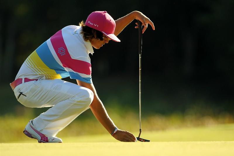 NORTON, MA - SEPTEMBER 04:  Rickie Fowler kneels down on the eighth green during the second round of the Deutsche Bank Championship at TPC Boston on September 4, 2010 in Norton, Massachusetts.  (Photo by Mike Ehrmann/Getty Images)