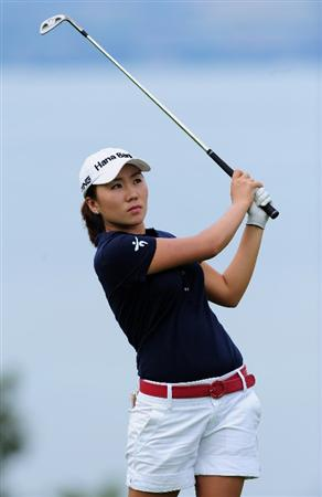 EVIAN-LES-BAINS, FRANCE - JULY 24:  In-Kyung Kim of South Korea plays her approach shot on the fifth hole during the second round of the Evian Masters at the Evian Masters Golf Club on July 24, 2009 in Evian-les-Bains, France.  (Photo by Stuart Franklin/Getty Images)