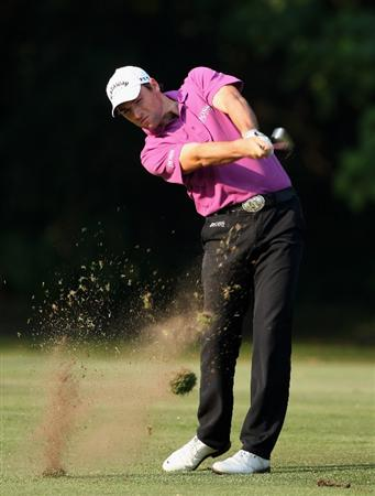 HONG KONG, CHINA - NOVEMBER 20:  Oliver Wilson of England plays his approach shot on the 15th hole during the first round of the UBS Hong Kong Open at the Hong Kong Golf Club on November 20, 2008 in Fanling, Hong Kong.  (Photo by Stuart Franklin/Getty Images)