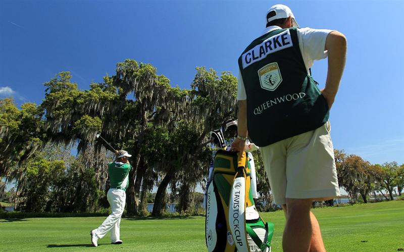 ORLANDO, FL - MARCH 14:  Darren Clarke of Northern Ireland and the Queenwood Club plays his second shot at the 9th hole during the first day of the 2011 Tavistock Cup at Isleworth Golf Club on March 14, 2011 in Orlando, Florida.  (Photo by David Cannon/Getty Images)