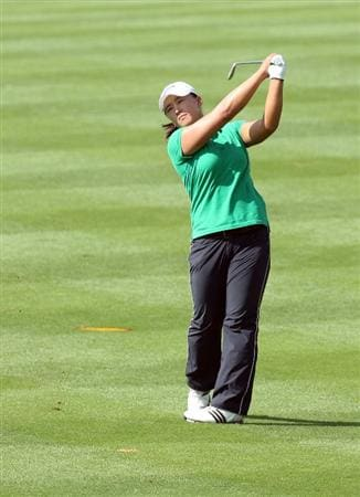 DUBAI, UNITED ARAB EMIRATES - DECEMBER 12:  Amy Yang of South Korea plays her second shot at the 3rd hole during the second round of the Dubai Ladies Masters on the Majilis Course at the Emirates Golf Club on December 12, 2008 in Dubai,United Arab Emirates  (Photo by David Cannon/Getty Images)