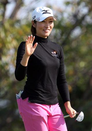 SHIMA, JAPAN - NOVEMBER 07:  Akane Iijima of Japan acknowledges the gallery on the 17th green during the round two of Mizuno Classic at Kintetsu Kashikojima Country Club on November 7, 2009 in Shima, Japan.  (Photo by Koichi Kamoshida/Getty Images)
