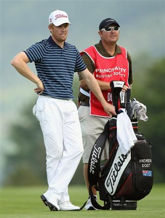 NEWPORT, WALES - JUNE 03:  Andrew Dodt of Australia waits with his caddie on the 18th hole during the first round of the Celtic Manor Wales Open on The Twenty Ten Course at The Celtic Manor Resort on June 3, 2010 in Newport, Wales.  (Photo by Andrew Redington/Getty Images)
