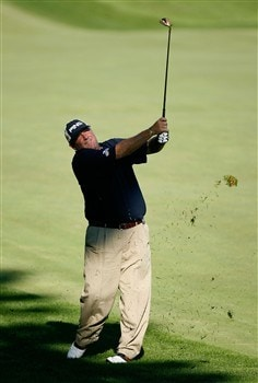 BLOOMFIELD HILLS, MI - AUGUST 08:  Mark Calcavecchia plays his second shot on the first hole during round two of the 90th PGA Championship at Oakland Hills Country Club on August 8, 2008 in Bloomfield Township, Michigan.  (Photo by Hunter Martin/Getty Images)