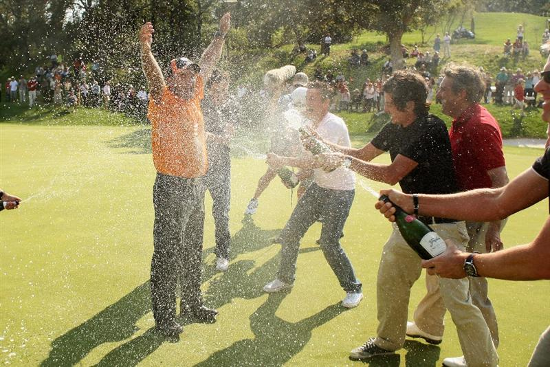 GIRONA, SPAIN - MAY 03:  Thomas Levet of France is soaked in champagne by fellow French golfers after winning the Open de Espana on a score of -18 under par at the PGA Golf Catalunya on May 3, 2009 in Girona, Spain.  (Photo by Warren Little/Getty Images)