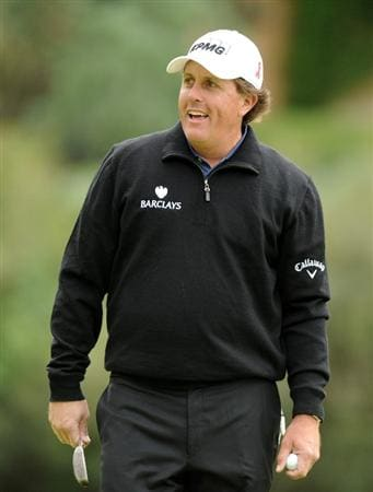 PACIFIC PALISADES, CA - FEBRUARY 18:  Phil Mickelson reacts to his birdie putt on the eighth hole during the second round of the Northern Trust Open at the Riviera Country Club on February 18, 2011 in Pacific Palisades, California.  (Photo by Harry How/Getty Images)
