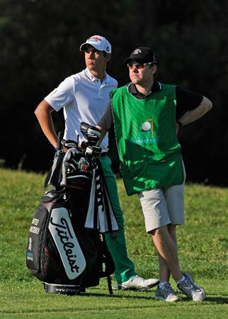 CASTELLON DE LA PLANA, SPAIN - OCTOBER 24:  Matteo Manassero of Italy with his caddie, Ryan McGuigan on the 15th hole during the final round of the Castello Masters Costa Azahar at the Club de Campo del Mediterraneo on October 24, 2010 in Castellon de la Plana, Spain.  (Photo by Stuart Franklin/Getty Images)