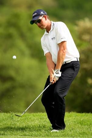 SUN CITY, SOUTH AFRICA - DECEMBER 04:  Henrik Stenson of Sweden chips in for eagle on the 14th during the first round of the Nedbank Golf Challenge at the Gary Player Country Club on December 4, 2008 in Sun City, South Africa.  (Photo by Richard Heathcote/Getty Images)