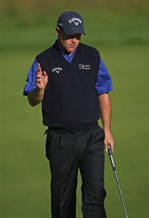 LUSS, SCOTLAND - JULY 09:  Alastair Forsyth of Scotland acknowledges the crowd after holing a birdie putt on the 11th green during the First Round of The Barclays Scottish Open at Loch Lomond Golf Club on July 09, 2009 in Luss, Scotland.  (Photo by Andrew Redington/Getty Images)