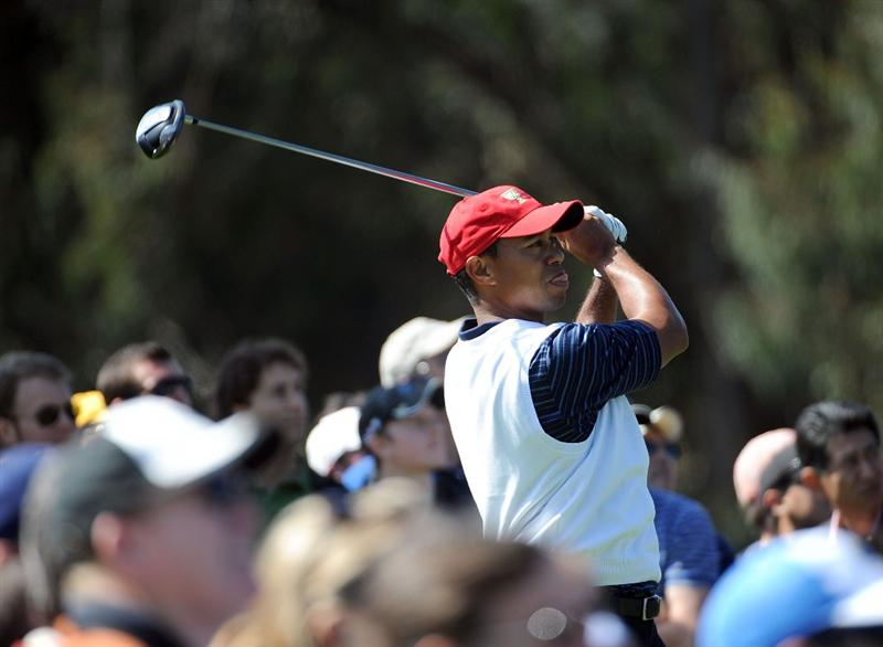 SAN FRANCISCO - OCTOBER 09:  Tiger Woods of the USA Team hits a tee shot on the fifth hole during the Day Two Fourball Matches of The Presidents Cup at Harding Park Golf Course on October 9, 2009 in San Francisco, California.  (Photo by Harry How/Getty Images)