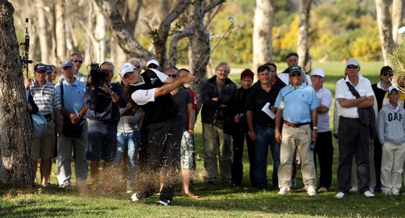 MALAGA, SPAIN - MARCH 26:  Paul Lawrie of Scotland plays his second shot on the 18th hole during the third round of the Open de Andalucia at the Parador de Malaga Golf Course on March 26, 2011 in Malaga, Spain.  (Photo by Ross Kinnaird/Getty Images)