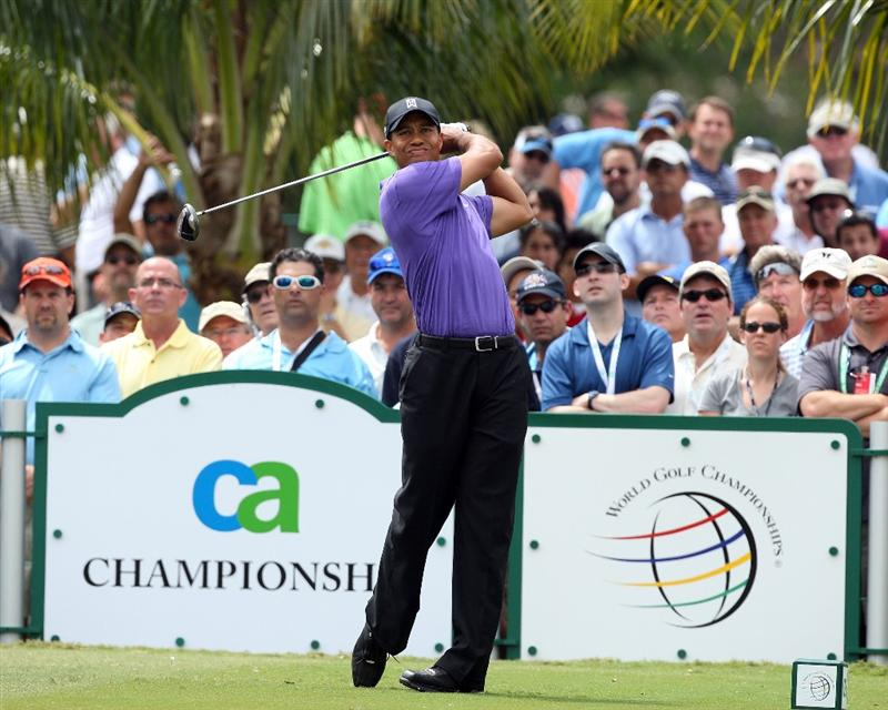 DORAL, FL - MARCH 13:  Tiger Woods of the USA tees off at the 3rd hole during the second round of the World Golf Championships-CA Championship at the Doral Golf Resort & Spa on March 13, 2009 in Miami, Florida  (Photo by David Cannon/Getty Images)