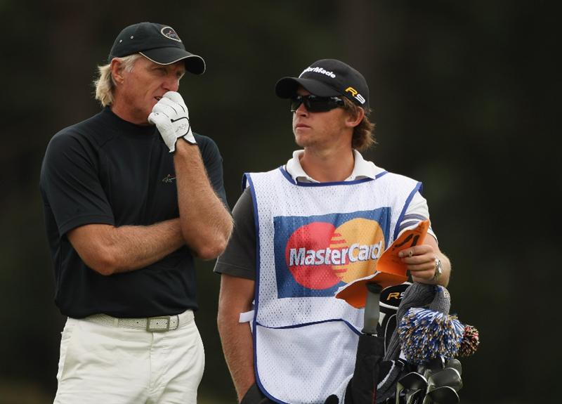 SUNNINGDALE, ENGLAND - JULY 25:  Greg Norman of Australia hears advice from his caddie during the third round of The Senior Open Championship presented by MasterCard held on the Old Course at Sunningdale Golf Club on July 25, 2009 in Sunningdale, England.  (Photo by Warren Little/Getty Images)