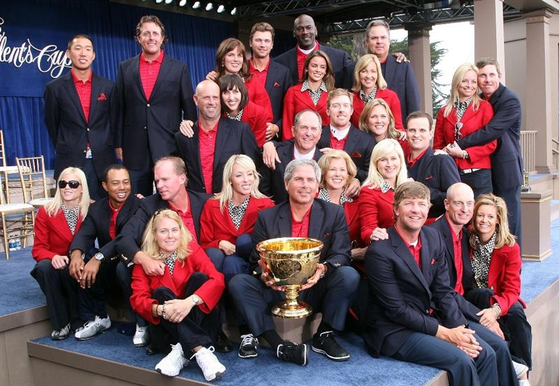 SAN FRANCISCO - OCTOBER 11:  Members of the USA Team pose on stage with their wives and companions at the closing ceremonies after the USA defeated the International Team 19.5 to 14.5 to win The Presidents Cup at Harding Park Golf Course on October 11, 2009 in San Francisco, California.  (Photo by David Cannon/Getty Images)