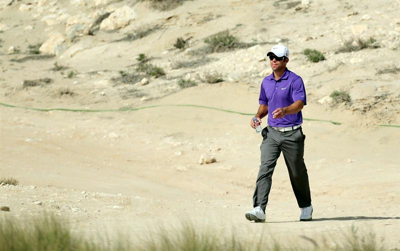 DOHA, QATAR - JANUARY 30:  Paul Casey of England walking of the 9th tee during the third round of The Commercialbank Qatar Masters at The Doha Golf Club on January 30, 2010 in Doha, Qatar.  (Photo by Ross Kinnaird/Getty Images)