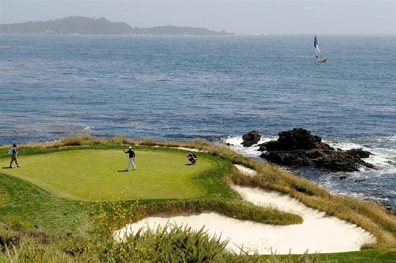 PEBBLE BEACH, CA - JUNE 17:  Paul Casey of England waves to the gallery on the seventh green during the first round of the 110th U.S. Open at Pebble Beach Golf Links on June 17, 2010 in Pebble Beach, California.  (Photo by Harry How/Getty Images)