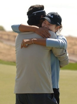 Hee-Won Han is greeted by her husband after Han's victory in the 2005 Office Depot Championship at Trump National Golf Club Los Angeles in Rancho Palos Verdes, California, September 3, 2005Photo by Steve Grayson/WireImage.com