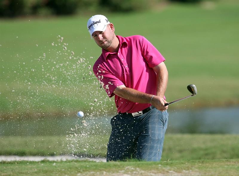 WEST PALM BEACH, FL - DECEMBER 07:  Ted Brown chips out of the greenside bunker on the eighth hole during the final round of the 2009 PGA TOUR Qualifying Tournament at Bear Lakes Country Club on December 7, 2009 in West Palm Beach, Florida.  (Photo by Doug Benc/Getty Images)