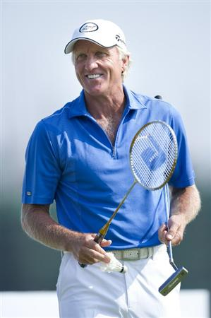 HAIKOU, CHINA - OCTOBER 29:  Greg Norman of Australia plays with a badminton raquect on the 15th hole during day three of the Mission Hills Start Trophy tournament at Mission Hills Resort on October 29, 2010 in Haikou, China. The Mission Hills Star Trophy is Asia's leading leisure liflestyle event which features Hollywood celebrities and international golf stars.  (Photo by Victor Fraile/Getty Images for Mission Hills)