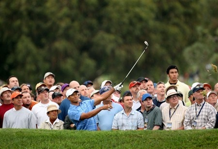 SAN DIEGO - JUNE 12:  Tiger Woods hits a shot on the first hole in front of the gallery during the first round of the 108th U.S. Open at the Torrey Pines Golf Course (South Course) on June 12, 2008 in San Diego, California.  (Photo by Ross Kinnaird/Getty Images)