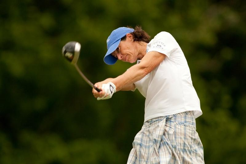 SPRINGFIELD, IL - JUNE 12: Juli Inkster follows through on a tee shot during the third round of the LPGA State Farm Classic at Panther Creek Country Club on June 12, 2010 in Springfield, Illinois. (Photo by Darren Carroll/Getty Images)