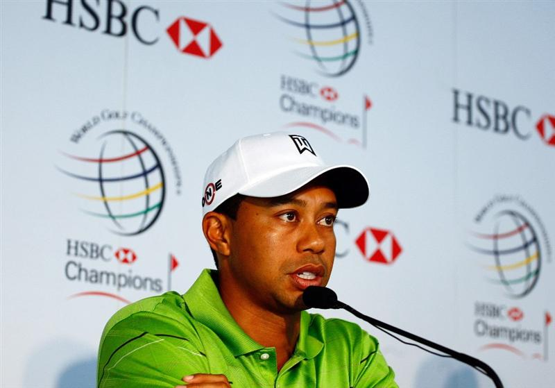 SHANGHAI, CHINA - NOVEMBER 04:  Tiger Woods of the USA speaks to the media prior to the start of the WGC-HSBC Champions at Sheshan International Golf Club on November 4, 2009 in Shanghai, China.  (Photo by Scott Halleran/Getty Images)