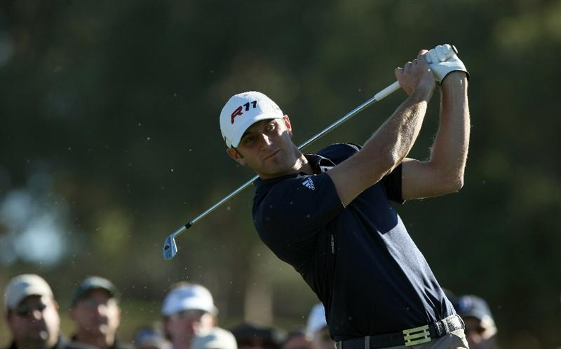 LA JOLLA, CA - JANUARY 28:  Dustin Johnson tees off the 12th hole during the second round of the Farmers Insurance Open at Torrey Pines on January 28, 2011 in La Jolla, California. (Photo by Donald Miralle/Getty Images)