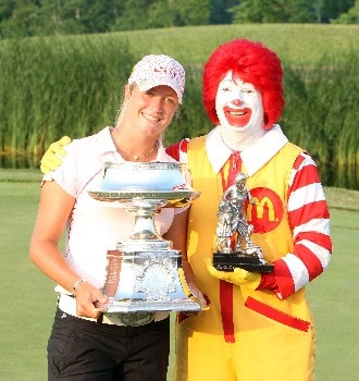 HAVRE DE GRACE, MD - JUNE 10:  Suzann Pettersen (L) of Norway holds the trophy with a person dressed as Ronald McDonald after the final round of the 2007 McDonald's LPGA Championship held at Bulle Rock golf course June 10, 2007 in Havre de Grace, Maryland.  (Photo by David Cannon/Getty Images)